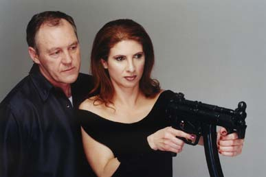 John Fox supervises Danielle Barht before firing the 9mm Heckler & Koch MP 5 K Machinegun
