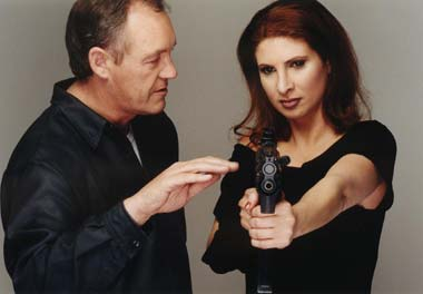 John Fox with Actress Danielle Barht discussing the 9mm Heckler & Koch MP 5 K Machinegun